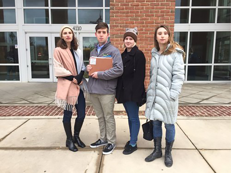 From left to right: Janine Gaspari, Gus Thomson, Molly Reagan, and Liz Mathews of Transparent GMU outside of the Fairfax Circuit Court before filing their lawsuit against George Mason University and the GMU Foundation.
